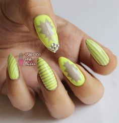 nude  neon, always a sweet combo…Essie - Sand Tropez  a Kiss Nail Art Striper polish in neon yellow. Not crazy about the point on the nails though