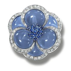 CHALCEDONY, SAPPHIRE AND DIAMOND BROOCH, VAN CLEEF & ARPELS.  Of flowerhead design, the centre set with cabochon sapphires, within blue chalcedony and brilliant-cut diamond petals, mounted in platinum,  signed Van Cleef & Arpels and numbered, case.