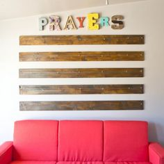 Create a DIY Prayer Wall with wood planks and some fun letters to create a dedicated space in your home for daily prayer and family worship.