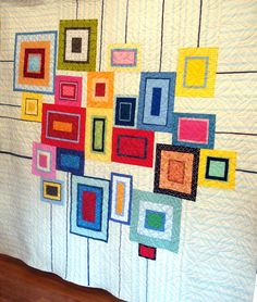 "Fun ""Modern City Quilt"" by Nancy Tanguay. I really like the thin black lines that extend to the edges of the quilt."