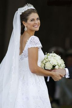 Princess Madeleine's wedding dress was created by the Italian designer Valentino Garavani. The Princess's tiara is privately owned, and was decorated with sprigs of orange blossom.