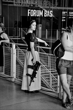 This is a lady after my own heart!!!  All dressed up with her machine gun  Brahaha