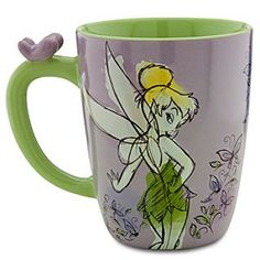 Disney Tinker Bell Mug | Disney StoreTinker Bell Mug - If you're thirsting for more Tink in your life, then drink in the delights of this Tinker Bell Mug. The molded bas relief design features two charming images of the posing pixie while the handle has a little butterfly perched on top.