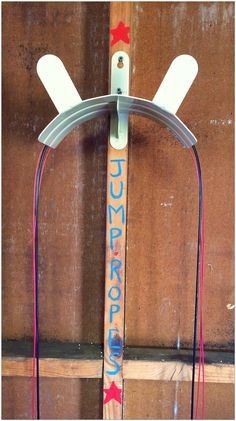 Home Gym - Crossfit home gym. Jump rope storage using water hose holder so speed ropes dont get kinks. - http://amzn.to/2fSI5XT