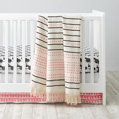 Our new Poodle Party Crib Bedding was designed exclusively for us by Gingiber, and includes an adorable poodle crib sheet and coordinating neon pink hand woven blanket.