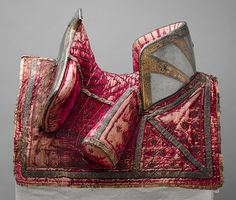 Saddle, ca. 1570–80  Italian (Milan)  Wood, textiles, iron, leather, steel, and gold    Wt. 22 lb. 1 oz. (10,024 g)  Rogers Fund, 1904 (04.3.252)  Metropolitan Museum