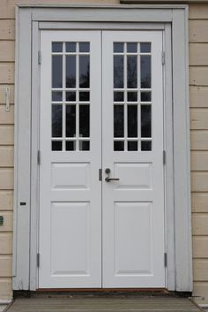 Old style white door with glass in it.