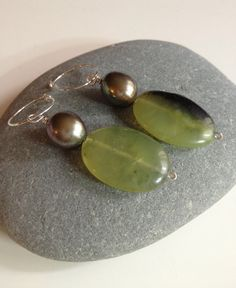Hey, I found this really awesome Etsy listing at https://www.etsy.com/listing/123176534/green-jade-black-baroque-pearl-earrings