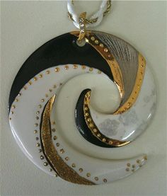 Gorgeous polymer clay spiral pendant - white faux marble, black, silver, accented with gold leaf (?) and gold beads