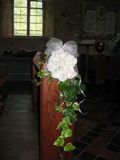 Pew ends - ivy & hydrangea - not keen on organza bow but like basic idea - bit more ivy though?