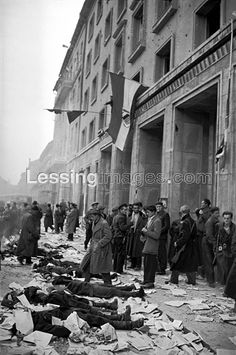 Dead members of the Secret Police, ordered to protect the Budapest headquarters of the Communist Party, lie lined up in front of the just conquered building. Budapest, Police, The Secret, Street View, Building, Party, Pictures, World, Buildings