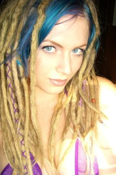 Wrapped dreadlocks with blue bangs.