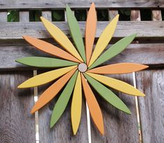 For your outdoor and indoor decorating this year I've created a colorful pine wood folk art style starburst wreath with a swirl in its design.  This friendly starburst wreath can be a subtle and refreshing welcome to guests at your front door this year. It will add a cheerful color to any outdoor or indoor wall. And, as a garden wall hanging it will lighten up your garden area throughout the year. Order your own custom color configuration from Laughing Creeks 12 colors available. Asparagus…