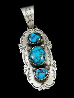 Turquoise Jewelry Necklace Navajo Sterling Silver Egyptian Turquoise Stamped Pendant - Gorgeous, high quality Egyptian turquoise set in sterling silver and surrounded by hand stamped designs. Signed by the Navajo artist, Bobby Johnson. Metal Clay Jewelry, Sea Glass Jewelry, Stone Jewelry, Silver Jewellery, Jewellery Shops, Diamond Jewelry, Jewelry Box, Jewelry Making, Blue Topaz Necklace