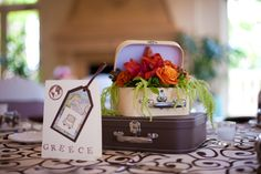 Travel Themed Wedding Suitcase Centerpieces - from the Davis wedding 10/03/10  Each table was a different country #traveltheme #centerpiece