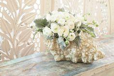 sea shell floral centerpiece arrangements   Beautiful flower arrangement of Ranunculus and ...   Floral arrangeme ...