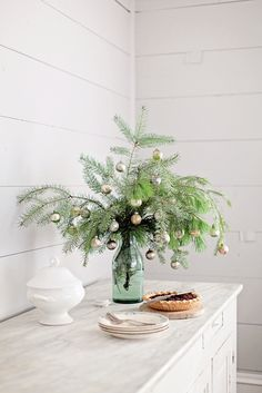 Decorate small branch clippings for a simple holiday arrangement