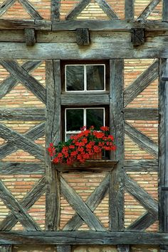 is a beautiful medieval village with a smattering of half timbered buildings.France is a beautiful medieval village with a smattering of half timbered buildings. Window Boxes, Window Sill, Old Windows, Windows And Doors, Red Geraniums, Garden Windows, Doorway, Gates, Old Houses