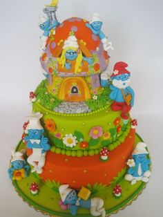 DON'T YOU JUST LOVE THE COLORS USED IN THIS SMURF CAKE