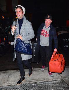 Long journey: Jesse Tyler Ferguson looked in great spirits as he arrived in NYC with his husband Justin Mikita on Sunday night