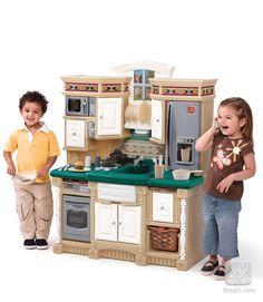 This might be the coolest kids toy kitchen I've seen...wow...and I'm pretty sure it's nicer than my kitchen! haha
