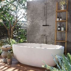 Curved form and deep interior, this impressive freestanding concrete bathtub provides breathtaking beauty and optimum comfort. Avalon's thick walls provide insulation to ensure that a hot, deep, relaxing soak will last and last. Concrete Bathtub, Outdoor Bathtub, Outdoor Bathrooms, Concrete Wall, Freestanding Bathtub, Outdoor Showers, Wooden Bathtub, White Bathrooms, Luxury Bathrooms
