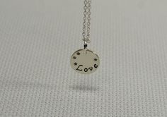 Sterling silver love charm necklace.
