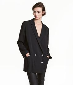 Black. Straight-cut, double-breasted, longer jacket in crêped wool-blend fabric. One chest pocket, front pockets with flap, and decorative buttons at cuffs