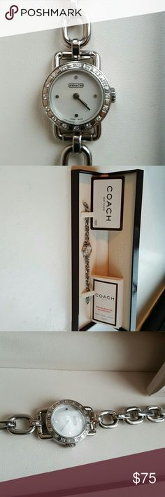 Coach women's silver bracelet watch Excellent condition, worn once or twice. Mother of pearl face, smaller type face, looks like crystals or very small diamonds around face, I can't tell which so we'll assume crystal! Comes with box and items as seen in pics. Brand new battery! Coach Accessories Watches
