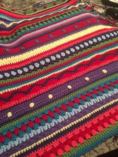 Ravelry: LoriSiddall's As-We-Go Stripey BlanketMy first attempt at a blanket. Thank you for the excellent instructions from  http://notyouraveragecrochet.com/as-we-go-stripey-blanket/