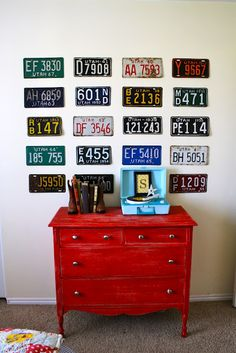 Cute boy's room idea: license plate display hung over painted dresser.