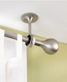 Ceiling curtain rods will elongate the appearance of your window.