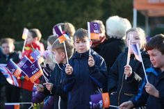 Children wave flags ahead of The Duchess of Cambridge (Kate Middleton) visit East Anglia's Children's Hospices in Norwich