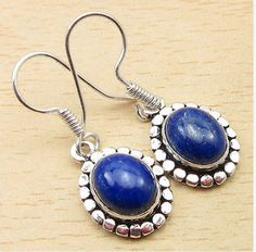 Dangling Lapis Lazuli Gemstone Handmade Earrings, Silver Plated 1 3/8 Inches OOAK, (One Of A Kind) handmade jewelry, healing stones  This artisan-made, statement, Dangling Lapis Lazuli Gemstone Handmade Earrings is sure to perfect finishing touch to any outfit.  We believe in the healing power of gemstones and thoughtfully select each stone for its individual powers and craft it into beautiful, wearable art. Handcrafted by highly skilled artisans who are trained to achieve perfection of…