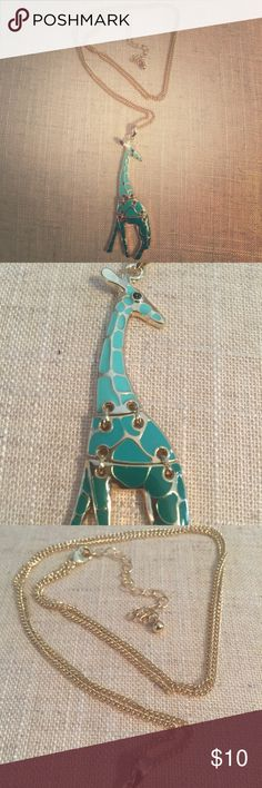 Women's giraffe necklace. This beautiful necklace adorns a giraffe displaying three different hues of green. This necklace is a reminder of how important our world's animal kingdom is. Celebrate this endangered species with this wonderful depiction of the giraffe. Jewelry Necklaces