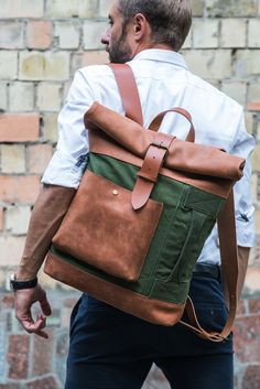 Versatile by design and built durable to last, the all-terrain Adventure Roll Top Backpack is made for the adventurist in you. FYI! Features 100% upcycled British army duffle exterior, leather shoulde