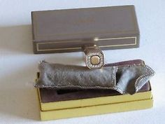 Avon Jewelled Lipstick Designer Case for Avon's Encore Lipstick.  Includes Case, Box and Flannel Pouch.  The case is gold tone and measures 3 inches long by 7/8 inches in diameter.  No lipstick is included.