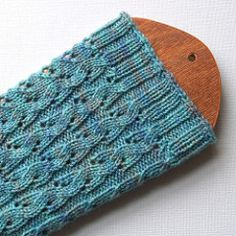 The beaches near where I grew up in Australia were full of those little critters that burrow in the sand and turn the surface into a fascinating series of little waves and ripples. The Beach Fog colourway of these socks contains all the hues of the sand and scrub of Victoria's south coast and the ripple pattern is reminiscent of the pippies, right down to their tiny breathing holes.