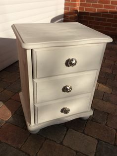 Rustoleum chalk paint winter grey pine bedside table drawers with decorative knobs.