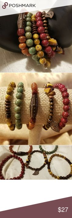 5 Piece handmade stretch bracelets ️Color      Burgundy- brown- green- tan(amber shell)  ️Size      7 1/2--8in.  ️Beads     ️4mm dark brown wooden beads     ️6mm brown round flat & round wooden beads     ️6mm amber shell beads      ️8mm brown striped polyresin beads     ️8mm burgundy & 8mm green/olive green beads     ️Mookaite topaz mix chip beads  ️wooden brown diamond bead ️copper/brown leaf charm  ️each bracelet was created on       clear stretch bead cord. Jewelry Bracelets