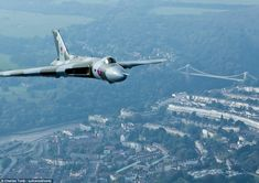 Earlier: The Vulcan is pictured here on Sunday passing over Bristol, with the Clifton suspension bridge visible in the background