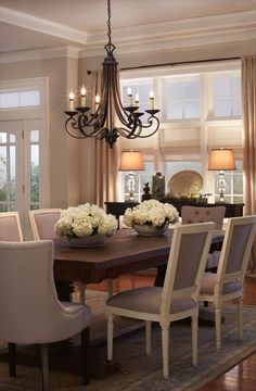 Dining Room decor ideas - Transitional style, grey upholstered seating, wood table, large chandelier.  This Silly Girl's Life