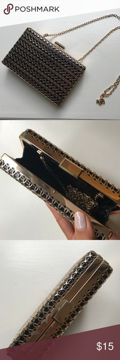 Gold Filigree Hard Box Clutch Gold metallic filigree and black hard box clutch. 6 x 3.75 inches with gold chain strap. Fits an iPhone 7! No-name brand. Bags Clutches & Wristlets