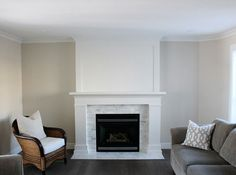 Living Room Makeover - White Painted Trim and Mantel - Marble Surround - Baby Fawn Walls - White Oak Hardwood Flooring - Satori Design for Living