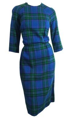 """1960s cobalt blue wool dress with greens and purples....very Joan Holloway! Elastic waist, three-quarter sleeves. Unlined. Back metal zip, by Gay Gibson. No flaws. measures 34-38"""" bust, 24-28"""" waist,"""