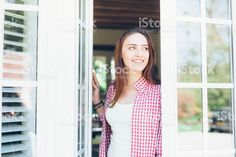 Young woman looking through the window royalty-free stock photo