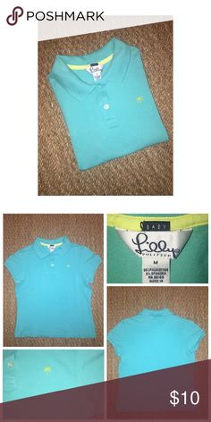 Lilly Pulitzer Polo Shirt Pre•loved Lilly Pulitzer Polo Shirt • Size M (10/12) • Cotton/Spandex Blend • Overall good condition as is, has some slight fading from normal wash and wear Lilly Pulitzer Shirts & Tops Polos