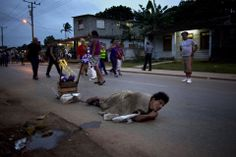 MAKING HIS WAY: A man dragged a stone chained to his ankle during a pilgrimage to a shrine in El Rincon, Cuba, Monday. Every year, thousands...