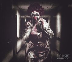 Madness the creepy medical clown standing in grunge hospital hallway with flashlight and tongue prong. Terminal treatment by Ryan Jorgensen