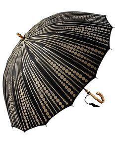 Gorgeous brolly with bamboo inspired curved wooden handle and lovely tassel- let it rain!